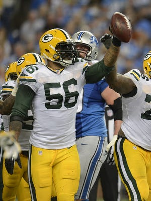 Green Bay Packers linebacker Julius Peppers (56) raises the ball after recovering a fumble against the Detroit Lions in the third quarter during Sunday's game at Ford Field in Detroit. Evan Siegle/Press-Gazette Media/@PGevansiegle