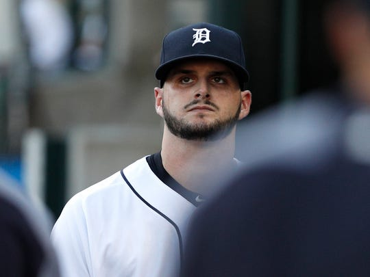 Tigers pitcher Myles Jaye (65) looks up from the dugout