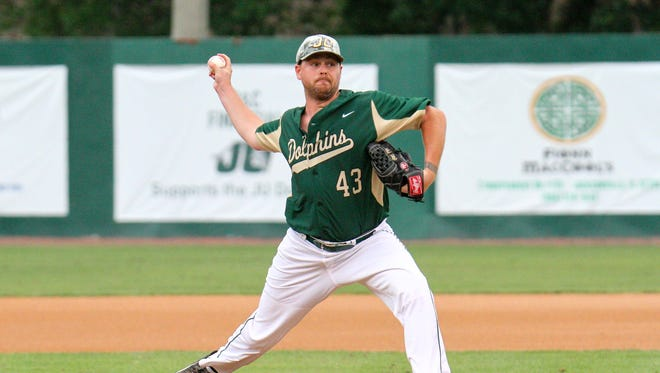 Pitcher Brian Holcomb delivers a pitch against Georgia Southern's Kody Adams during his first start for Jacksonville University on April 28 in Jacksonville. It was the first college game for Holcomb, a 1998 Mason High graduate who is a member of the Wounded Warrior Project and an active duty Navy corpsman.