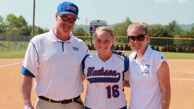 Madison senior Michaela Drewnoski set a NCHSAA softball record for career home runs (41) on Wednesday in Marshall. She is pictured with Patriots coach Andy Gregg and assistant Rebekah Huff.
