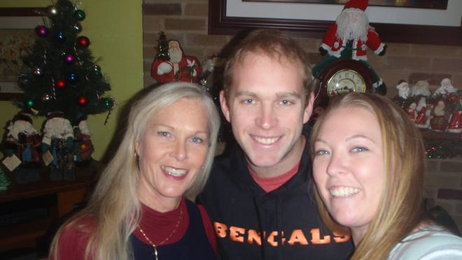 Matt Gold of Fishers, Ind., is pictured with his mom, Brenda (left) and sister Jenny Gold. Brenda Gold is 54 and trying out for the Cincinnati Bengals cheerleading squad.