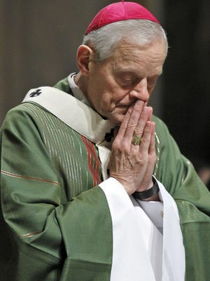 In this Wednesday, Oct. 20, 2010 file photo, Archbishop Donald Wuerl prays as he celebrates Mass at the Cathedral of Saint Matthew the Apostle in Washington. Pope Francis has accepted Friday Oct. 12, 2108 the resignation of Washington Cardinal Donald Wuerl after he became entangled in two major sexual abuse and cover-up scandals and lost the support of many in his flock. (AP Photo/Alex Brandon, File)