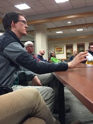 Nathaniel Burns of Winooski poses a question Tuesday