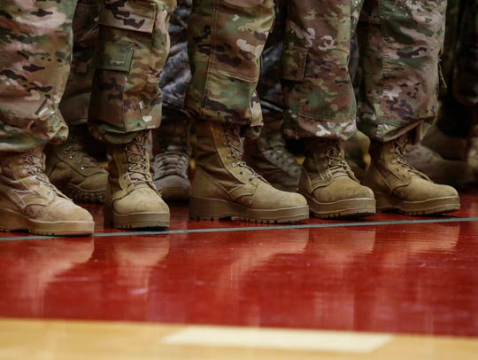 Members of the Iowa National Guard 248th Aviation Support Battalion line up during a send-off ceremony at Boone High School in Boone on Friday, Sept. 29, 2017.