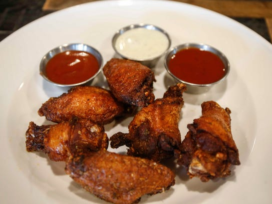 Chicken wings with an assortment of dipping sauces