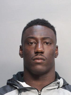 University of Miami football player JaWand Blue is shown, Tuesday, July 8, 2014. Court and jail record show that Blue and teammate Alexander Figueroa face sexual battery charges.