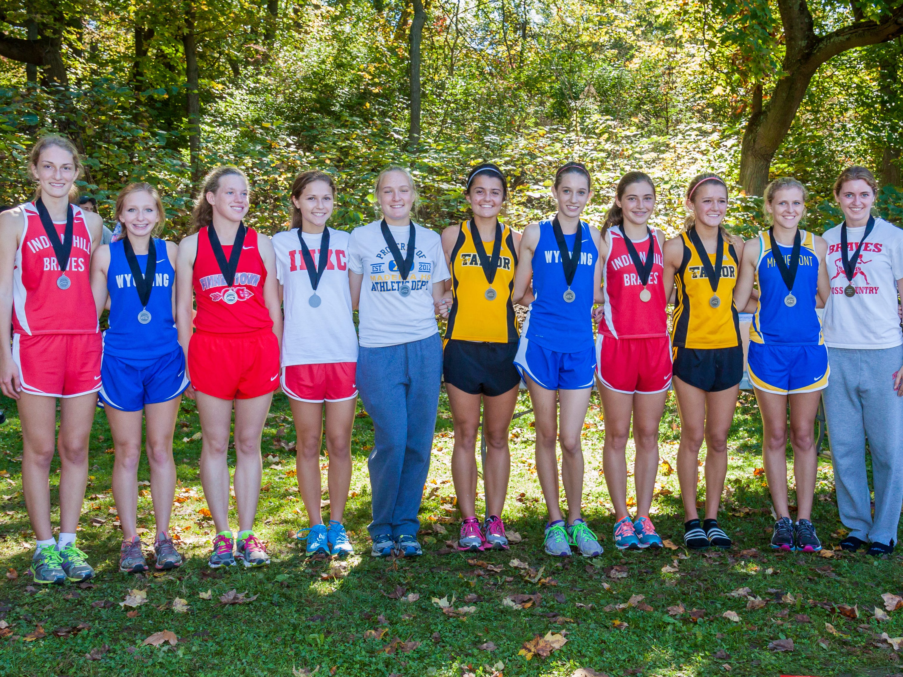 The Wyoming girls cross country team finished second at the Cincinnati Hills League Championship last October at Sharon Woods. Making top-10 finishes for the Cowboys were Terra Forsythe (fifth from right) and Whitney Elsass (second from left).
