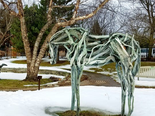 """Kua,"" is a bronze sculpture by Deborah Butterfield on display on the grounds of the Leigh Yawkey Woodson Art Museum in Wausau."