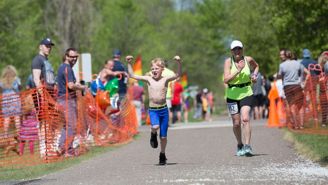 George Dahlager crosses the finish line at the Lake Wobegon Trail Marathon last May.