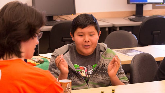 Participant in the 2014 Colorado State University Math in Action in Computer Science camp Kyle Begay learns about probability with Zombie Dice, June 4, 2014. CSU's MACS camp provides Native American students from Cortez Middle School in Cortez, Colorado hands-on training with math concepts and their applications in computer science.