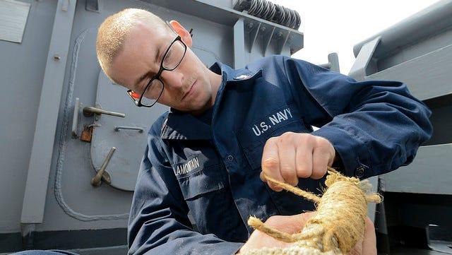 Boatswain's Mate 3rd Class Cody Lamountain of Reno at work on the USS Bonhomme Richard.