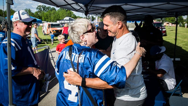 Dena Polston meets kicker Adam Vinatieri at Morrows Meadow in Yorktown during the Colts Fan Fest Tuesday evening. Polston, who is blind, was assisted through the autograph line by friends and family.