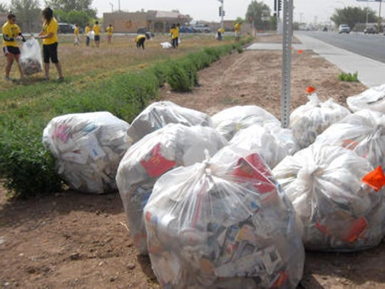 Bags of garbage lay on the side of South Valley Drive
