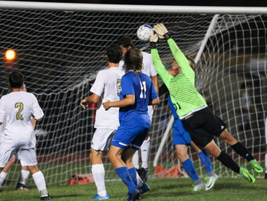 Collin May heads the ball past Elco goalkeeper Matthew