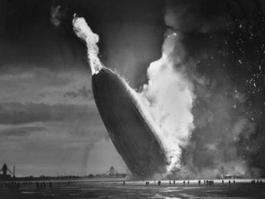 The German dirigible Hindenburg crashes to earth, tail first, in flaming ruins after exploding on May 6, 1937, at the U.S. Naval Station in Lakehurst, N.J. The 1920s and 1930s were the golden age of dirigibles which crossed the Atlantic Ocean in about three days -- faster than a ship. The Hindenburgwas the largest airship ever built at 804 feet long and flew up to 85 miles per hour while held aloft by hydrogen, which was highly flammable.