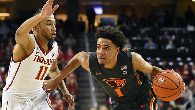 Oregon State guard Stephen Thompson Jr., right, averaged a team-high 16.3 points per game this season.