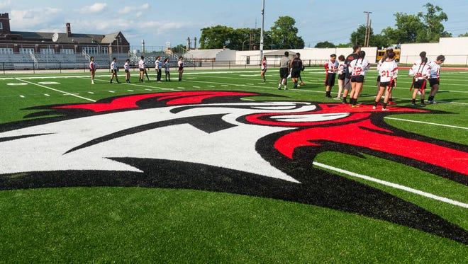 Vineland junior girls warm up on the new playing surface at Gittone Stadium on Thursday, June 7.