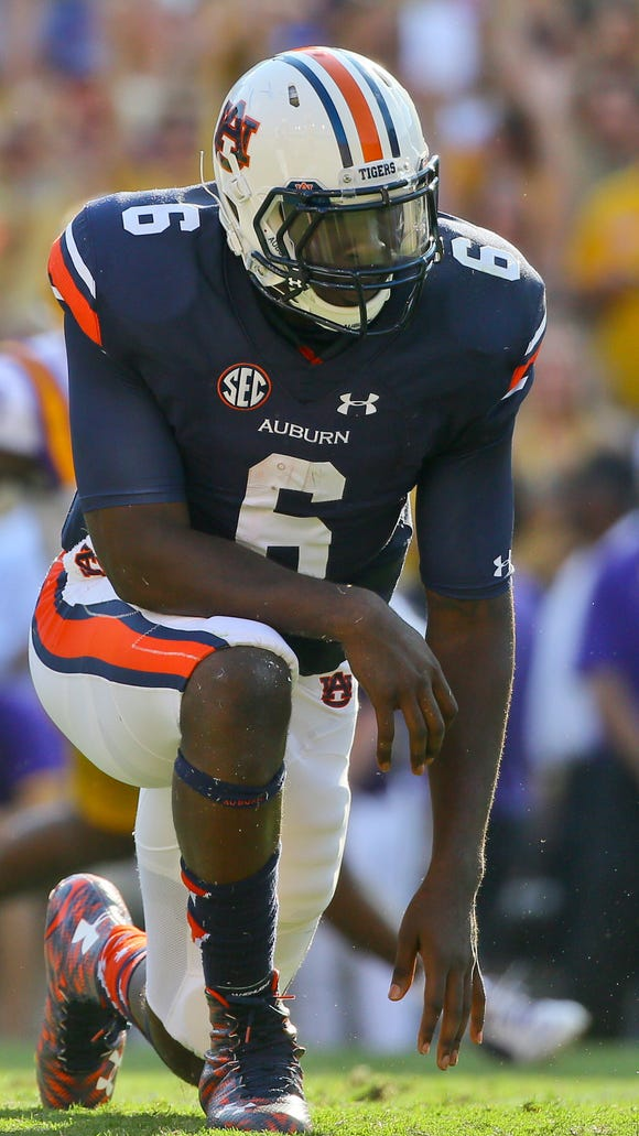 Auburn quarterback Jeremy Johnson reacts after a fumble is lost to the LSU Tigers during the third quarter of a game at Tiger Stadium. Mandatory Credit: Derick E. Hingle-USA TODAY Sports