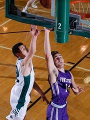 Fowlerville's Geoffrey Knaggs, right, gets a layup against Williamston's Sean Cobb, Friday, Jan. 12, 2018, in Williamston, Mich. Williamston won 99-66.