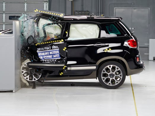 The Fiat 500L as it hurtles into the barrier. The Insurance Institute for Highway Safety found the vehicle and four others are considered poor in its narrow offset front crash test