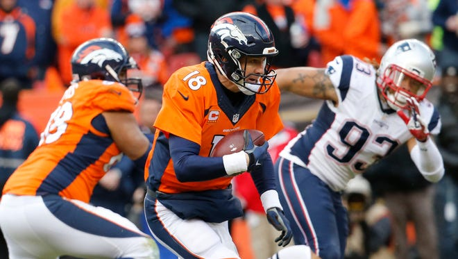 Peyton Manning runs the ball against the Patriots in the third quarter of the AFC Championship Game .
