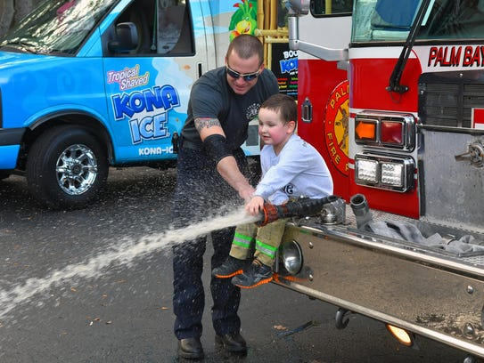 4 year old AJ Demarest got a surprise visit from Nick Swoboda and the rest of the crew of Station 5 of the Palm Bay Fire Dept. and Santa Claus. AJ suffers a rare form of muscular dystrophy as well as other health issues, and has braved many hospital stays and treatments. His Facebook page is AJ's Platoon.