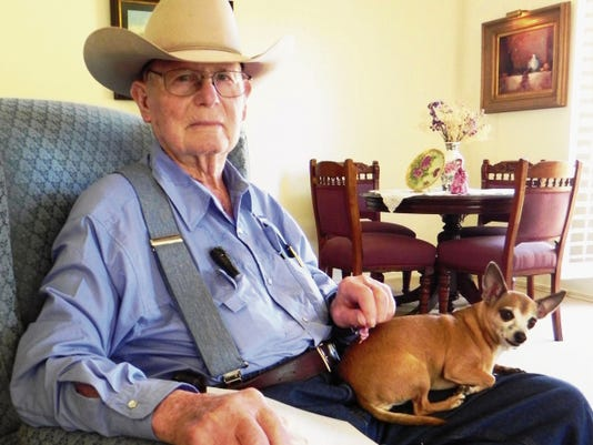 Joe Stell and his tiny faithful canine, Wooksie, sit in his favorite chair in their home on Landsun Circle. Joe, Wooksie and his wife, Verna, split their time between their home in town and their ranch near Slaughter Canyon on Colwell Ranch Road.