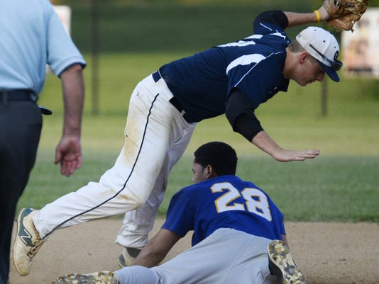 Pleasureville's Les Castro slides safely into second base as Glen Rock's Troy Miller avoids him during a Central League baseball game in Glen Rock on July 7. Glen Rock beat Pleasureville, 6-0.