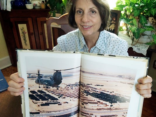 Kathi Stayman of Spring Garden Township shows a photo, Tuesday, Oct. 13, 2015, of Fleet Hospital 15 in Afghanistan where she served as a Navy Reserve nurse. She recently retired after serving since 1983. Bill Kalina - bkalina@yorkdispatch.com