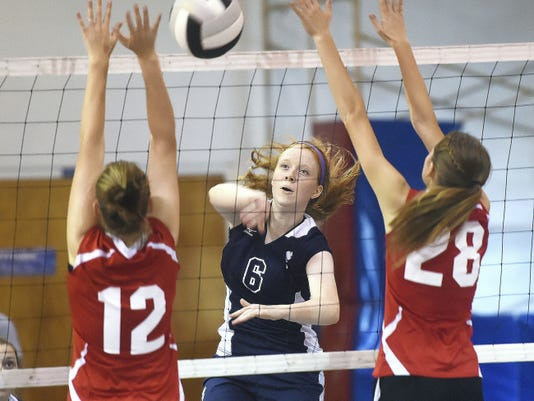 Cumberland Valley Christian's Harli Bergau, left, and Loryn Sanders, right, try to block a ball against Lexy Poe, of Shalom Christian. Poe paced the Flames with seven kills, and Shalom won, 3-0.