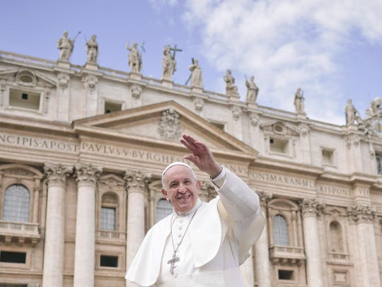 Pope Francis leaves at the end of his weekly general