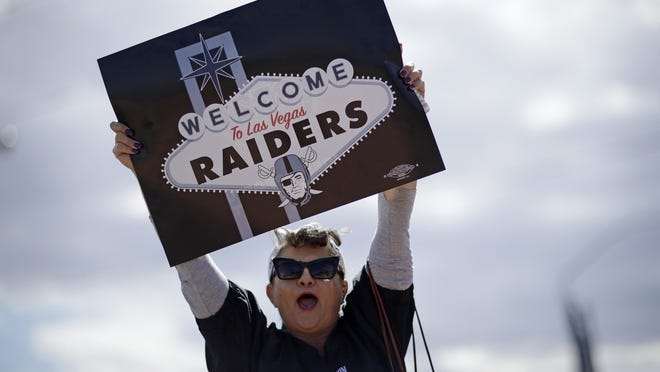 Labor union member Geraldine Lacy celebrates March 27, 2017, in Las Vegas. NFL team owners approved the move of the Raiders to Las Vegas in a vote at an NFL football annual meeting in Phoenix.