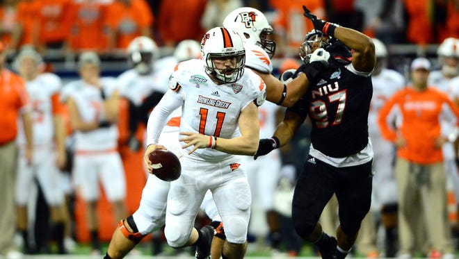 Bowling Green quarterback Matt Johnson, left, scrambles out of the pocket against Northern Illinois at Ford Field.