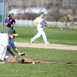 BFA pitcher Brady Green scoops up a slow roller earlier this month.