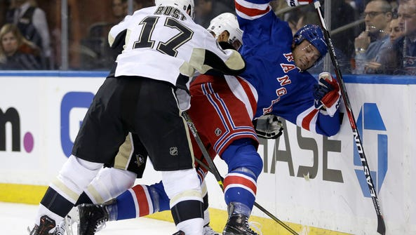The Rangers' Viktor Stalberg, right, is checked by