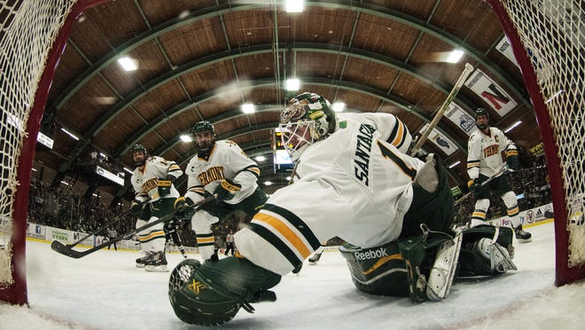 Catamounts goalie Mike Santaguida (1) dives to try and make a save during the men's hockey game between the Providence Friars and the Vermont Catamounts at Gutterson Fieldhouse last season.