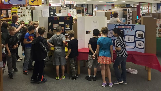 Cass students check out the many exhibits at the school's science fair.