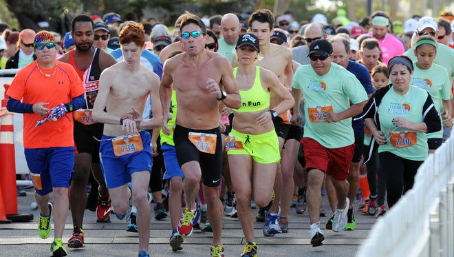 Participants take off at the start of the FLORIDA TODAY 8K in Front St. Park in 2016.