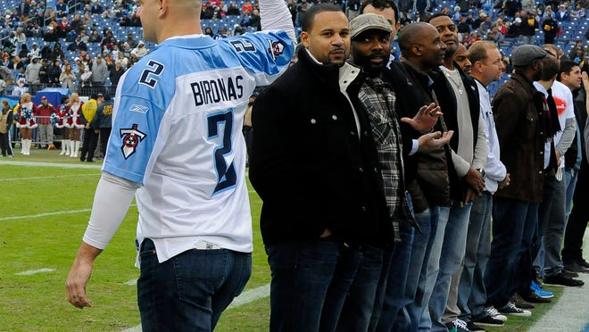 Former Titan Donnie Nickey points to Bironas' name on his jersey during a ceremony to honor former team members before the game against the Jets at LP Field Sunday, Dec. 14, 2014, in Nashville.