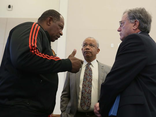 From left, Muhammad Salaam, with Community Intervention Task Force, and Norm Griffiths discuss the results from a investigation of gun violence in Wilmington with Dr. Paul Silverman, associate deputy director for Health Information and Science at the Delaware Division of Public Health.