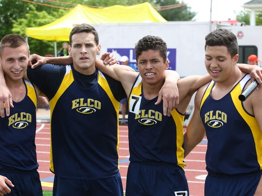 Elco's, from left, Blaine Troutman, Colton Lawrence, Austin Eldridge and Ryan Rolon celebrate their 1600 meter relay championship.