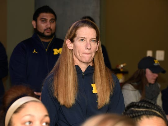 Michigan women's basketball coach Kim Barnes Arico watches Monday night's NCAA Women's Basketball selection show with her team at the Revel & Roll in Ann Arbor.