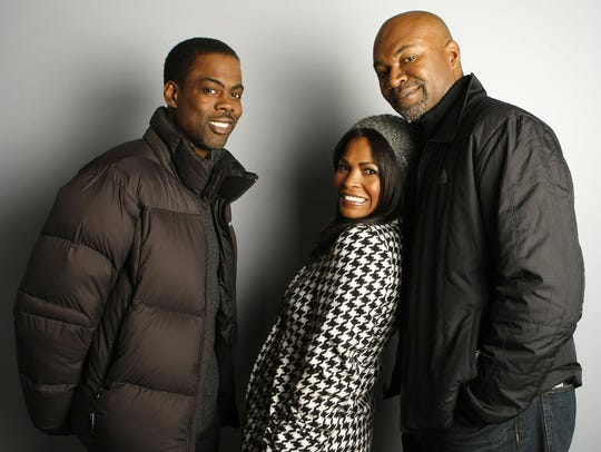 Chris Rock, Nia Long and Nelson George(right)  poses