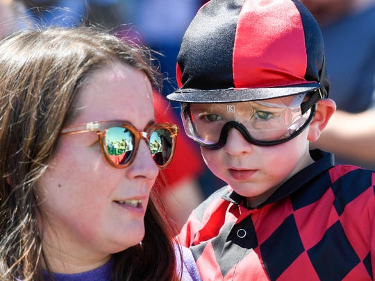 Horse racing fans Kerri Hancock and son Landon Hancock, 6 years-old, from Evansville, take in the sights and sounds of race day at Ellis Park featuring Birds of a Feather Derby and Humpty-Dumpty Derby Saturday, July 7, 2018.