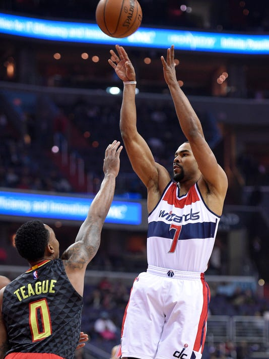 FILe - In this April 14, 2016, file photo, Washington Wizards guard Ramon Sessions (7) takes a shot against Atlanta Hawks guard Jeff Teague (0) during the first half of an NBA basketball game, in Washington. The Charlotte Hornets have added some depth in free agency.Center Roy Hibbert and point guard Ramon Sessions agreed to terms with the Hornets, a person with knowledge of the situation told The Associated Press on Tuesday, July 5, 2016. (AP Photo/Nick Wass, File)