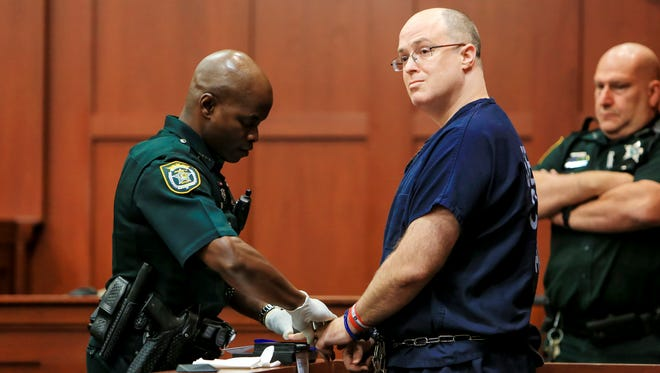 Matthew Apperson is fingerprinted after his sentencing at the Seminole County Criminal Justice Center on Monday, Oct. 17, 2016, in Sanford, Fla. Apperson, who was convicted of shooting at George Zimmerman as the two drove down Lake Mary Boulevard in separate vehicles and was sentenced Monday to 20 years in prison. Zimmerman is the former neighborhood watch volunteer who was acquitted of second-degree murder after fatally shooting unarmed teenager Trayvon Martin in 2012. (Jacob Langston/Orlando Sentinel via AP)