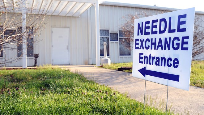 A sign points to the entrance to the Community Outreach Center in Austin, Ind.,  on Saturday, April 4, 2015. Indiana Gov. Mike Pence granted a 30-day extension to the nascent needle exchange program in Scott County.