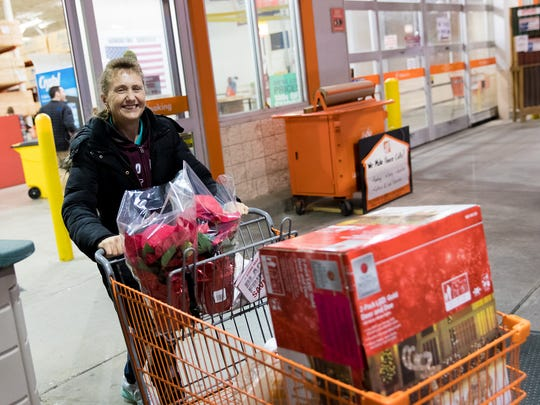 "Linda Dubbs of Hanover leaves Home Depot with her purchases during Black Friday shopping. Dubbs, pictured here at 6:49 a.m. had been out shopping since 2:30 p.m. Thanksgiving Day. ""As long as I keep going, I'm okay,"" she said."