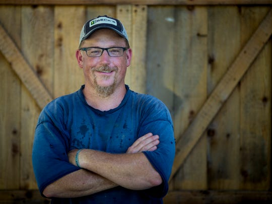Richard Stewart poses for a portrait at Carriage House Farm in Miami Township. His passion is offering Cincinnatians an alternative to buying food shipped from across the country or the world.