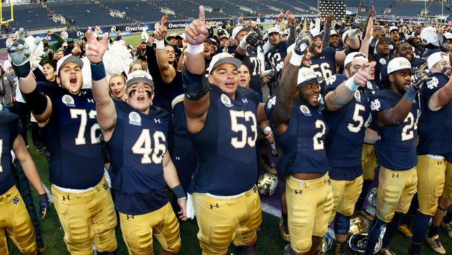 Jan 1, 2018; Orlando, FL, USA; Notre Dame Fighting Irish players celebrate their win over LSU Tigers in the 2018 Citrus Bowl at Camping World Stadium. Mandatory Credit: Reinhold Matay-USA TODAY Sports